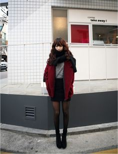 high skirt, black tights, short boots
