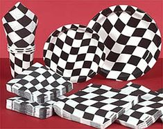 Use our checkered flag race day tableware at your race day bash.