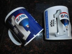 Mugs branded with RE/MAX No.1 campaign logo