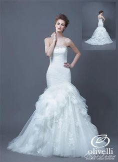 The magnificent Haldana dress from the Enzoani collection is a mermaid style dress with a little... pinned with Pinvolve