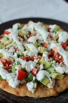 Fresh Greek Pizza with Homemade Tzatziki....Yummy...you make your own crust too!