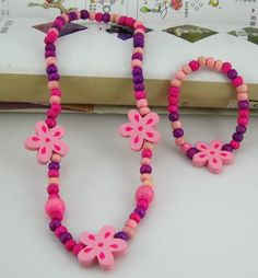 Set 12 Necklace and bracelet set  Flowery shape Made from wood  From China  RM12 per set    PRE ORDER now..