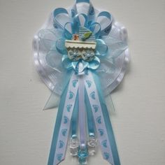Awesome Mommy Baby Shower Corsage In Blue And White With Footprint Printed Ribbon