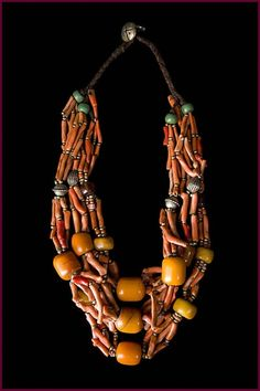 Imazighen tribal necklace from Morocco. Twelve strands of museum quality trade coral from the 1800's interspersed with silver, trade beads, and amber.
