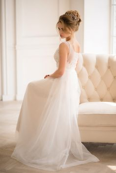 Gracefully constructed with a delicate lace illusion neckline and floral appliqué, this lovely sheath gown gives off a romantic yet elegant look