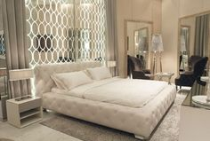 Art Deco Master Bedroom with Baxton Studio Stella King Crystal Tufted Bed, simple marble tile floors, High ceiling