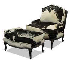 Old Hickory Tannery - Black and white cowhide bergere chair and ottoman. Love.