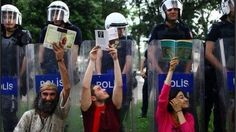 The protesters were reading books to the police as a part of their peaceful protest while...