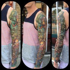 Amazing full sleeve Calvin and Hobbes tattoo