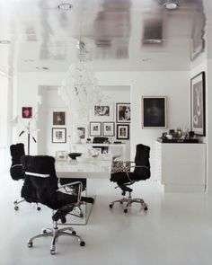 love that high-shine silver ceiling in this office space! // modern + clean office