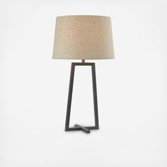 Minimalism at its finest, the Ranger table and floor lamp collection combine to create a magnificent illustration of open frame architecture. Featuring a single geometric shape and balanced with a crossing bar at the base, this lamp collection exhibits the refining qualities of mid-century modern style with a modern design sensibility. The 28-inch Ranger table lamp is finished with a savory oil rubbed bronze and topped with a 15-inch diameter oatmeal tapered drum shade.