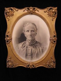 Antique 19th century black and white oval portrait photograph in gilt elaborately carved wooden frame. Circa 1880. - $145    Framed measurements are 25 inches height x 21 inches width.    Measurements of the oval image are 19 inches height x 15 inches width.    All Inquiries    or    clientservices@dejavuantiquesandcollectables.com