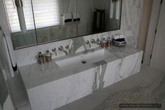A stylist bathroom design example with marble slabs. Marble Slabs, Calacatta Marble, Double Vanity, Natural Stones, Mirror, Interior Design, Bathroom, Furniture, Home Decor