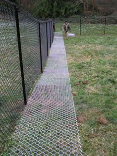 "the grass will grow through the ground matting and won't even be visible after awhile.no dog is going to get through feet wide, 9 gage fencing used as a ""ground mat"". Do keep dogs from digging under fence Dog Backyard, Backyard Fences, Chickens Backyard, Backyard Landscaping, Backyard Ideas, Landscaping Ideas, Dog Friendly Backyard, Yard Fencing, Dog Yard"