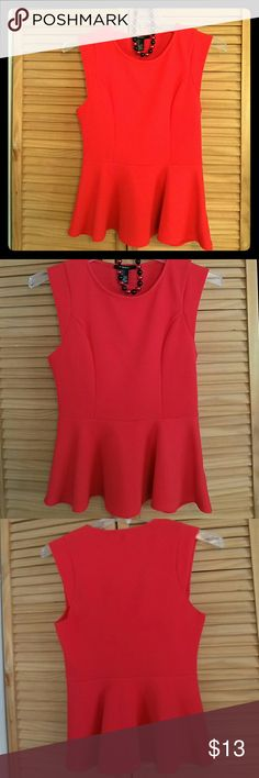 A GRATE PEPLUM TOP Simple but elegant top. Used only once. It's in excellent condition. 97% polyester,  3%spandex. Forever 21 Tops Tunics