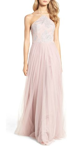 metallic embellished gown by Hayley Paige Occasions. Glistening floral detail covers the modified-halter bodice of a tulle-skirt gown made all the more airy looking in a ...