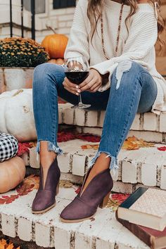 "Walk into the fall season in style with ""The Valerie Bootie in Windsor Wine"" featuring a sleek faux leather material with a top of the foot slit, closed toe, and 3-inch block heel! For a more comfortable fit, we recommend ordering a 1/2 size down from what you typically wear. For example, if you normally wear a size 7.5, we recommend ordering a size 7."