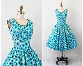 1950s dress / 50s floral dress / Blue, White, and Black Floral Print Dress with Black Velvet Bow