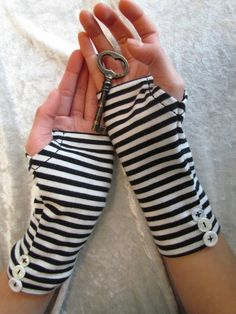 Look at these gloves - they are the gloves from the new Alice and Wonderland movie!! So cool