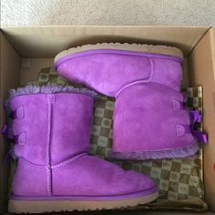 Purple uggs Purple ugh a with bows on the back, kids 4 but I'm a women's 5.5 and they fit perfectly, great condition, worn 4 times and come in the box.            Will take offers!!! Shoes Winter & Rain Boots