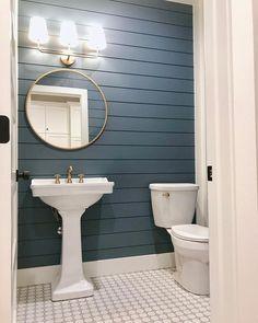 blue shiplap bathroom wall // white and blue bathroom