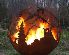 High Mountain Outdoor Fire Pit featuring a Cougar, Bear, and Big Horn Sheep created by artist Melissa Crisp.