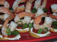 Mini Shrimp Cocktail Appetizers from Food.com:   From Kraftfoods(dot)com website.  I made these for a party and I've had so many people request the recipe.  Kraft calls for using finely chopped onions but I skipped that just to make it an even faster appetizer to get on the table.