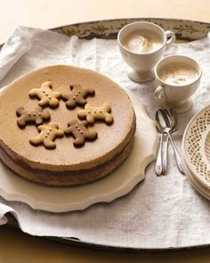 Gingerbread Cheesecake - A molasses-gingerbread crust doubles as dough for the cookies that top this charming holiday dessert.