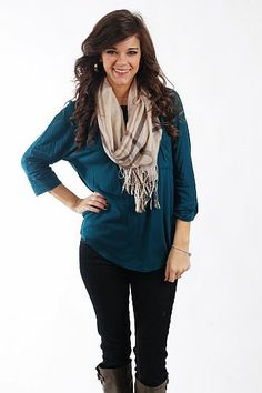 """The Ava Pocket Tee, Teal $37.50  This piece is absolutely a necessity for every girl! The solid colored top is super soft with three-quarter length sleeves and a rounded neckline, and we love the added detail of the pocket on the front! We bet you'll want this in every color!   Fits true to size. Miranda is wearing a small.   From shoulder to hem:  Small - 26.5""""  Medium - 27.5"""""""