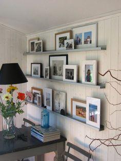 Fotos | Fotolijstjes muur op rails, leuk!