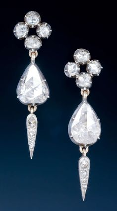 A very fine pair of antique diamond earrings, the rose cut diamond cluster, suspending a large pear shaped diamond with rose cut diamond drop, mounted in silver and gold, circa 1850.