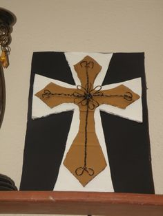 Cross with hand twisted wiring, and cardboard