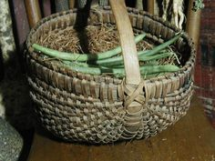 egg gathering basket....of course I use a basket to collect my eggs in. It's old..but that scoop Bowl has me wondering...:) A change is a good as a rest they say.