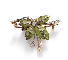 An Art Nouveau plique-a-jour enamel and diamond brooch pendant. Unmarked.