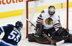 Chicago Blackhawks goaltender Corey Crawford (50) can't stop this shot from Winnipeg Jets' Mark Scheifele (55) during third period NHL action in Winnipeg on Thursday, October 29, 2015. THE CANADIAN PRESS/John Woods)
