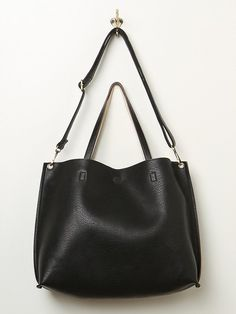 113d544999 $68, Black Leather Tote Bag: Free People Slouchy Vegan Tote. Sold by Free