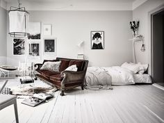 Bright White And Grey Studio Apartment With A Vintage Dark Red Velvet Sofa