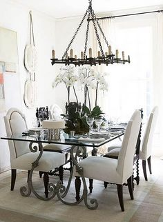 love the white, iron and upholstery....love the chandelier