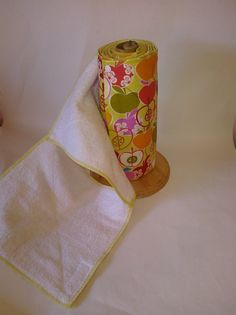 """This listing is for 12 flannel/terry snapping unpaper towels. These towels are made of one layer of flannel and 1 layer cotton terry cloth. They are serged around the edges for durability and feature a unique """"X"""" stitching across each towel to secure the layers together. They measure approximately 10""""x11"""" and fit a standard paper towel roll. The high quality plastic resin snaps are are placed so that all towels are interchangeable."""