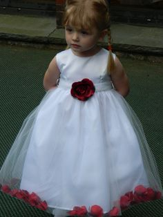 Red & white dress filled with silk rose petals for  #flower girl ... Wedding ideas for brides, grooms, parents & planners ... https://itunes.apple.com/us/app/the-gold-wedding-planner/id498112599?ls=1=8 … plus how to organise an entire wedding, without overspending ♥ The Gold Wedding Planner iPhone App ♥