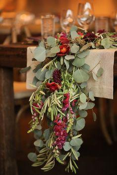 eucalyptus table runner - photo by Pepper Nix Photography http://ruffledblog.com/deer-valley-resort-wedding-with-a-burgundy-gown