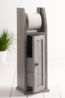 Next Wooden Toilet Roll Holder - Grey A rustic wooden toilet roll holder with a cupboard to store three extra toilet rolls or hide away cleaning products. Farmhouse Toilet Paper Holders, Wooden Toilet Paper Holder, Recessed Toilet Paper Holder, Toilet Paper Roll Crafts, Rope Shelves, Wooden Shelves, Toilet Roll Holder Grey, Small Bathroom Storage, Wooden Bathroom