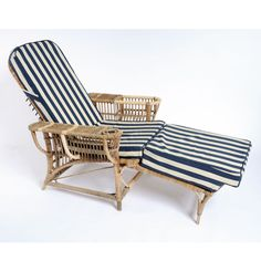 A Rattan Lounger With Srtiped Cushion