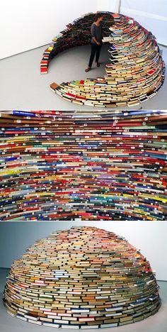 I wonder how many times this artist stacked these books in the igloo shape...or are they glued together?