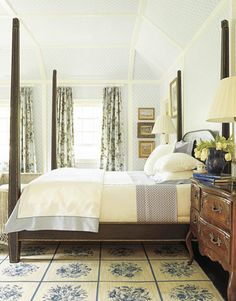 John Oetgen: Four-Poster Bed--Wallpaper is Blythe Diamond, chair and curtain fabric is Hortensia, all Scalamandré. Patterned bed linens are Lulu DK Matouk.