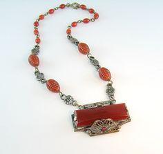 Art Deco Czech Carnelian Glass Necklace Silver Flowers Filigree Frame 1930s Jewelry. $99.00, via Etsy.