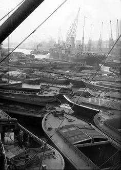 Wartime goods and supplies are unloaded from barges and boats in the London docks, on the River Thames, Nov. London Pictures, London Photos, Old Pictures, Vintage London, Old London, East London, London Docklands, London History, British History
