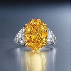 Perfect colour for the season! This Fancy Vivid Yellowish-Orange diamond of 6.94 ct will be sold in New York on December 7. Image via @christiesjewels . . #christiesjewels #jewels #diamond #coloureddiamond #orangediamond #ring #NewYork #7DEC16 #HighJewelleryDream