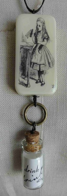 Alice In Wonderland Steampunk Domino Altered Art Pendant Handmade. $15.00, via Etsy.