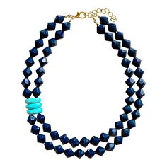 One of our most delightful statement pieces, this necklace is all pop!  Available in lipstick pink, nautical navy, or bright orange, all embellished with genuine turquoise stone accents and an oversize burnished gold clasp and Swell Caroline logo charm.   The details:  This acrylic bead necklace is set with genuine turquoise stone accents and secures with a sturdy oversize burnished gold clasp closure.  The longest strand measures 18 inches in length.  Necklace comes with a two inch…